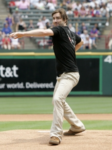 Luke throws out an opening pitch