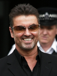 George Michael is all smiles as he leaves a London courthouse