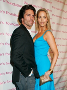 Elizabeth Berkley and hubby, Greg, pose at the charity party
