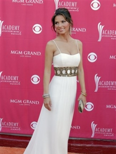 Lady in white: Shania Twain makes a grand entrance