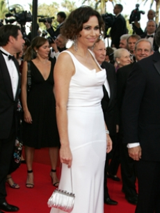 Minnie Driver arrives in a white gown at the Cannes Film Festival