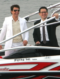 Tom Cruise and director J.J. Abrams arrive via boat to the Tokyo screening