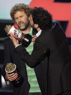 Sacha Baron Cohen gives Will Ferrell a peck on the cheek
