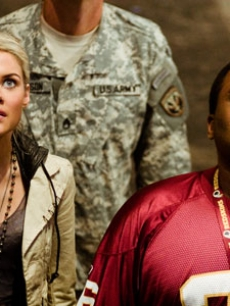 Rachael Taylor and Anthony Anderson look on