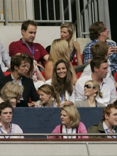 Prince William's girlfriend Kate Middleton watches from their box
