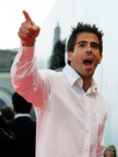 Director Eli Roth gestures to the crowd in Italy