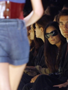 Demi Moore and Clive owen check out the Miss Sixty runway show