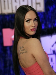 Megan Fox displays her tat as well