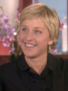 Ellen smiles on the set of her show