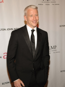 Newsman Anderson Cooper arrives for the AIDS benefit