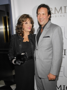 Joan Collins and Percy Gibson arrive for the film premiere