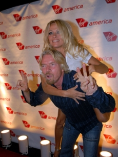 Pamela Anderson & Richard Branson celebrate a Virgin America flight