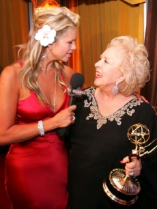 Nancy O'Dell celebrates with Doris Roberts