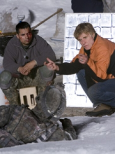 Michael Pena and director Robert Redford on the set