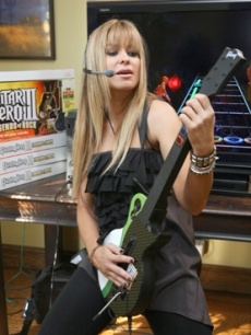 Carmen Electra rocks out while playing Guitar Hero at an event in LA
