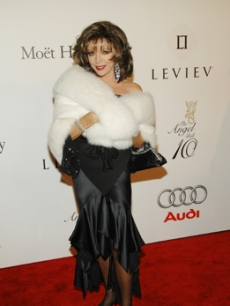 Joan Collins poses for pics on the red carpet