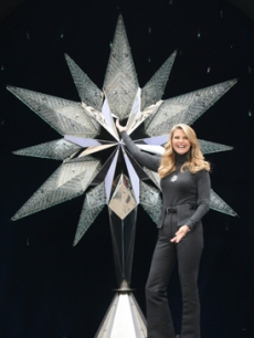 Christie Brinkley with Rockefellar Center's Christmas tree Swarovski star