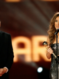 Prince Albert presents Celine Dion with an award in Monaco