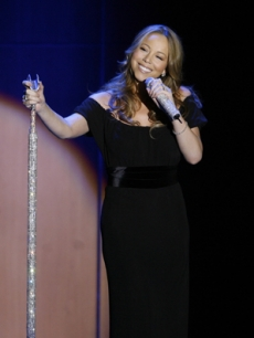 Mariah Carey takes the stage at the Glamour awards