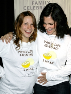 Lili Taylor shows off her baby bump to Parker Posey at the gala