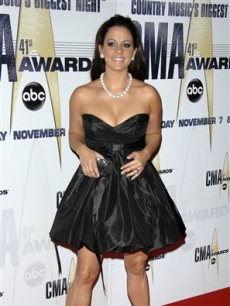 Sara Evans hits the CMA red carpet in a black dress