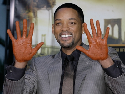 Will Smith puts his hands in cement in Hollywood...