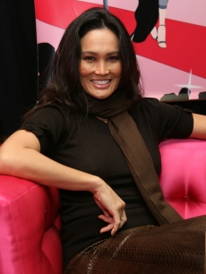Tia Carrere relaxing at the 'Stuff You Must…' Lounge