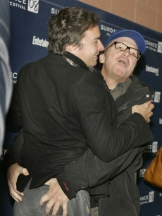 Tom Arnold enthusiastically greets Jimmy Fallon at the premiere of their film 'The Year of Getting to Know Us' at Sundance