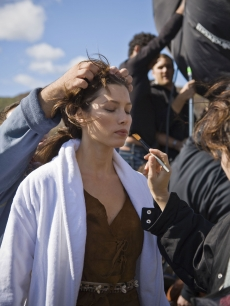 Jessica Biel has makeup applied on the set of a photo shoot