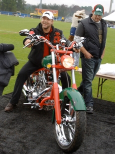Russell Crowe, co-owner of the Rabbitohs rugby team, tries out his new Rabbitohs themed motorcycle