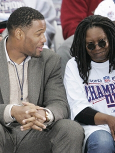 NY Giants Michael Strahan with Whoopi Goldberg during a victory ceremony