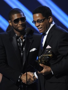 Album of the Year winner Herbie Hancock gets a handshake from Usher onstage