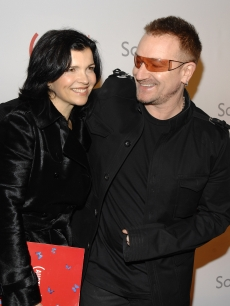 Bono and wife Ali Hewson attend The (Red) Auction to raise money for the treatment of HIV/AIDS in Africa  at Sotheby's