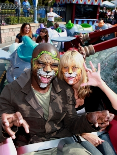 Heidi Klum and hubby Seal get their faces painted a ride 'Dumbo' at Disneyland!