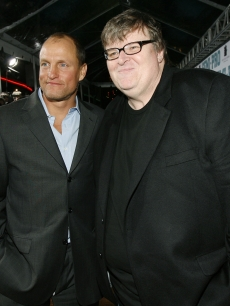 Woody Harrelson & Michael Moore catch up on the  red carpet