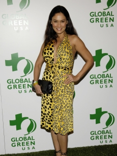 Tia Carrere arrives in a bright animal-print dress!