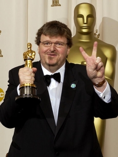 Michael Moore posed backstage with his Oscar in 2003 after giving a 