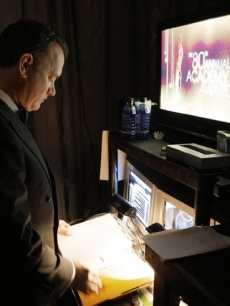 Tom Hanks reads over an Oscar script