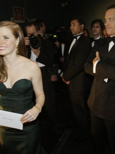 Amy Adams prepares to take the Oscar stage as Tom Hanks looks on