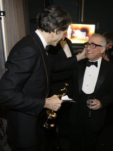 Daniel Day-Lewis gives Martin Scorsese a pat on the cheek