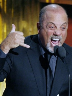 Billy Joel speaks before inducting John Mellencamp into the Rock and Roll Hall of Fame