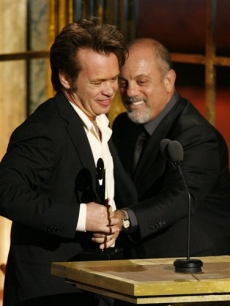 John Mellencamp accepts his award from Billy Joel