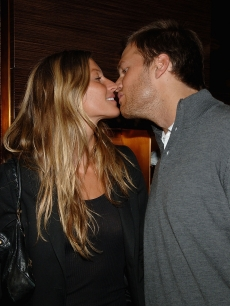 Gisele Bundchen and Tom Brady steal a kiss at the Ermenegildo Zegna event in NY