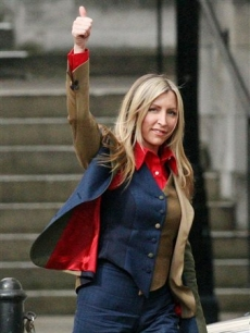 Heather Mills gives the thumbs up, as she leaves the Royal Courts of Justice 