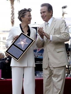 Annette Bening, with husband Warren Beatty by her side, receives her star