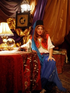 Ellen DeGeneres dons gypsy attire when going undercover as a fortuneteller at Universal Orlando Resort