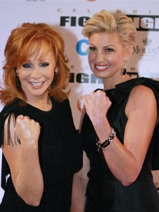 Reba McEntire and Faith Hill pose on the Fight Night red carpet