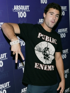 Brody Jenner motions to the press at the after-party