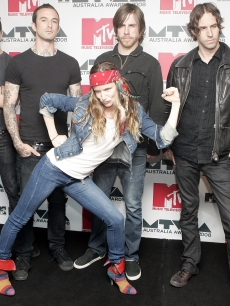Juliette Lewis and The Licks strike a pose on the NME carpet