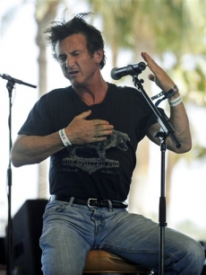 Sean Penn busts a dance move as he addresses the crowd during the third day of Coachella